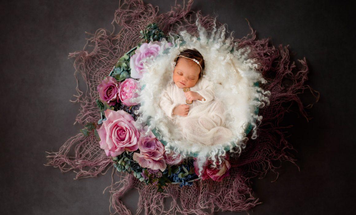 Newborn baby artwork photo in a basket
